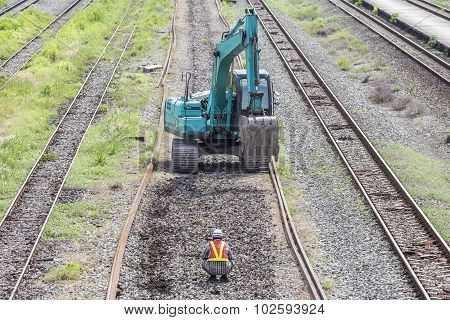 Excavator On Railroad Work