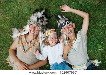 happy children with native american costumes