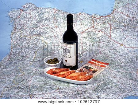 Spanish wine and tapas with a map.