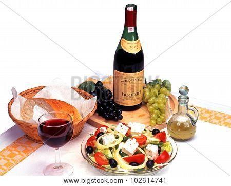 Greek salad and wine.