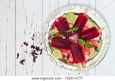 Refreshing mexican style ice pops - watermelon hibiscus lime paletas - ice pops - popsicles served o