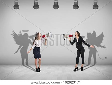Businesswomen stands with shadow on the wall