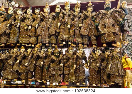 Rows of traditional Burmese puppets called
