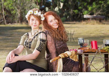 Pair Of Smiling Pagan Women