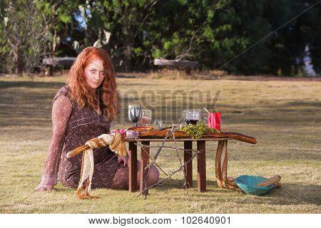 Pagan Priestess At Altar With Wine