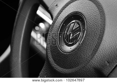 VW badge on a steering wheel