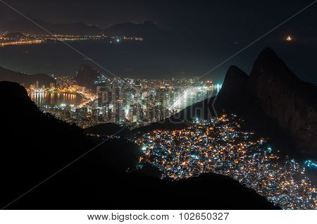 Rocinha Slum at Night and Ipanema District Behind the Mountains