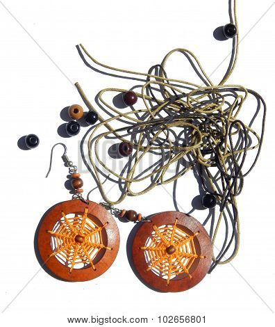 Abstract background with orange earrings, beads, ropes for bracelets