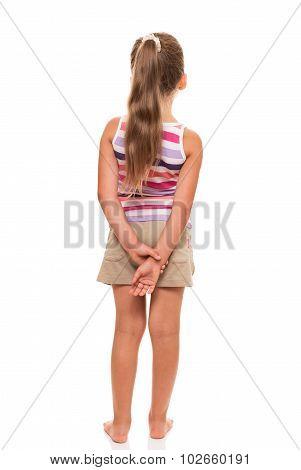 Little girl standing back on white background