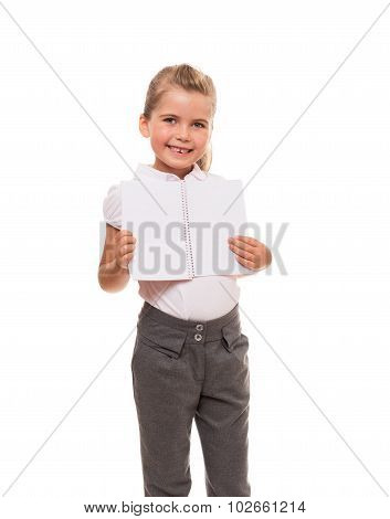 Little girl holding open notebook and smiling