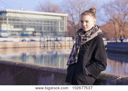 Pretty Caucasian Teenage Girl Posing Outdors In Trendy Black Coat.