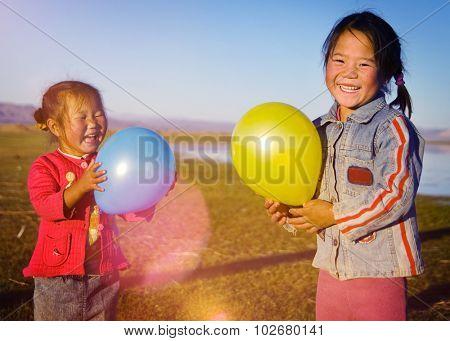 Asian Girls Playing Lake Balloon Rural Mongolian Concept