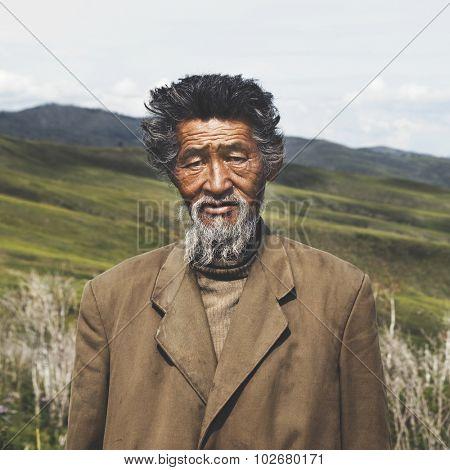 Portrait Mongolian Man Field Senior Tranquil Solitude Concept