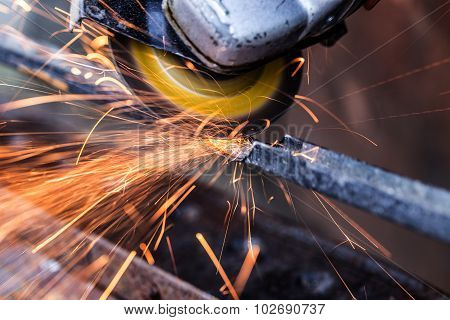 Sparks from grinding machine in workshop. Industrial background industry. poster