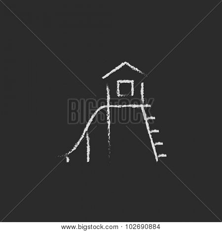 Playhouse with slide hand drawn in chalk on a blackboard vector white icon isolated on a black background.