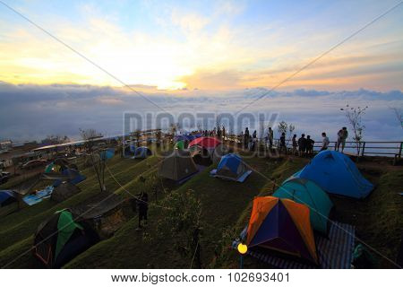 Unidentified traveler camping on the mountain