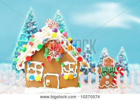 Gingerbread House With Man And Trees