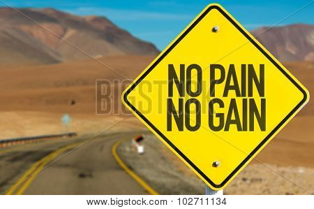 No Pain No Gain sign on desert road