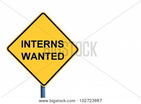Yellow Roadsign With Interns Wanted Message