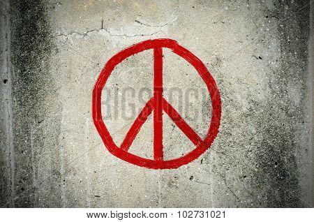 Red Peace Symbol Graffiti On Grunge Ciment Wall