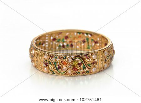 Isolated Indian golden bracelet with intricate craftsmanship.