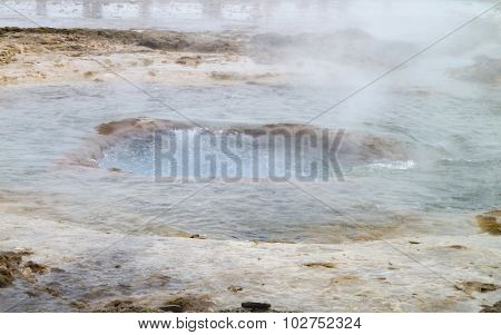 outdoor scenery including a geyser seen in Iceland poster