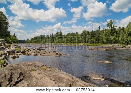St. Louis River Runs Through A Rocky Streambed Through A Pine Wooded Forest In Jay Cooke State Park,