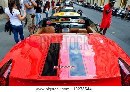 PARIS, FRANCE - AUGUST 09, 2015: close-up shot of Ferrari. Ferrari S.p.A. is an Italian luxury sports car manufacturer based in Maranello. Founded by Enzo Ferrari