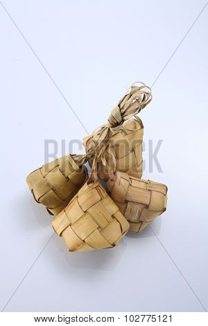 Ketupat (Rice Dumpling) On white Background. Ketupat is a natural rice casing made from young coconut leaves for cooking rice during eid Mubarak
