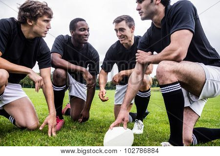 Rugby players discussing their tactics at the park