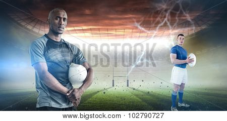 Rugby player holding rugby ball against rugby pitch