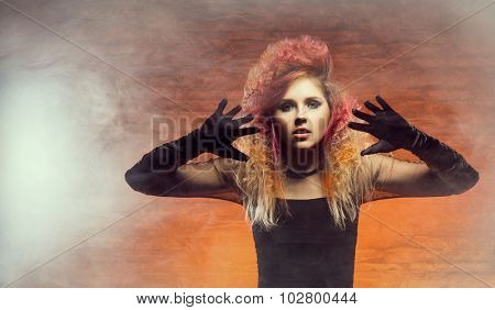 Beautiful witch casting a spell using hands. Halloween concept.