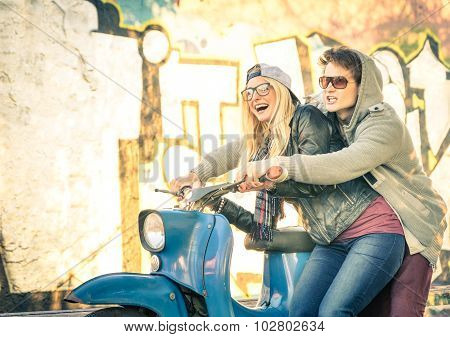 Young Couple Of Lovers Haviing Fun On A Vintage Scooter Moped - Handsome Man In Playful Attitude