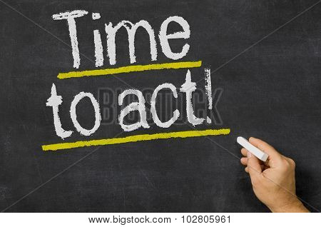 Time To Act Written On A Blackboard