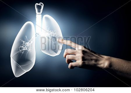 Close up of hand touching lungs sign
