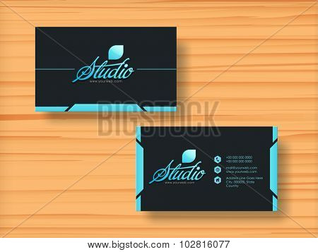 Creative horizontal business card, visiting card or name card set on wooden background.