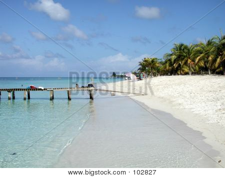 A beautiful day at the beach in West Bay, Roatan, Honduras. White sandy beach and crystal clear water. poster