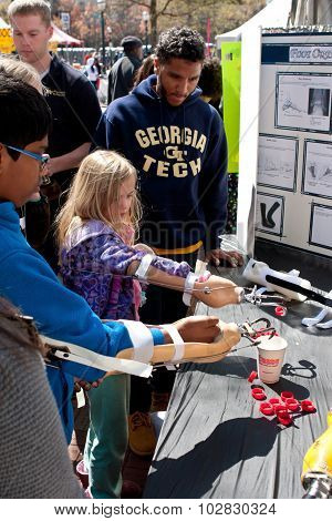 Kids Practice Using Prosthetic Arms At Atlanta Science Fair