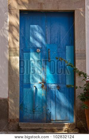 Classic Entryway with old blue wooden doors in Guanajuato Mexico