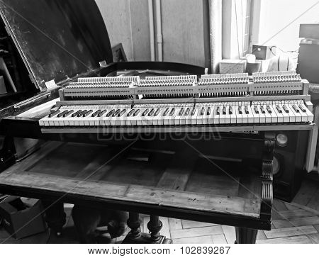 Piano restoration photo in black and white colors poster