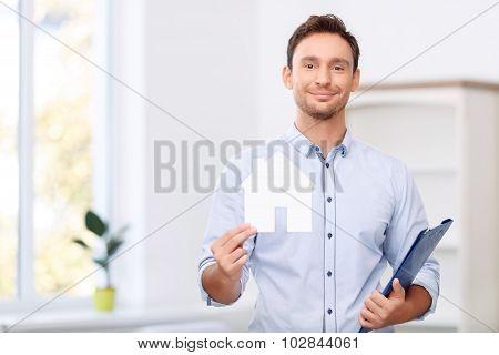 Pleasant realtor holding card
