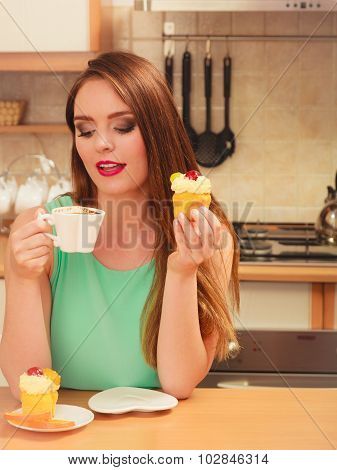 Woman Drinking Coffee And Eating Delicious Cake.