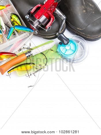 Fishing Tackles And Rubber Boots On White