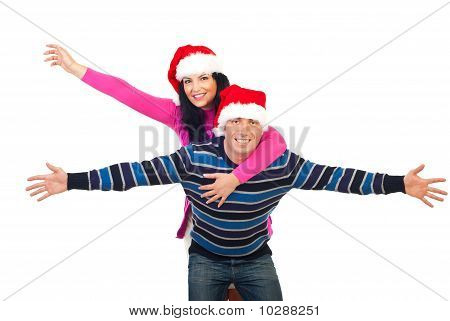 Cheerful Couple In Piggy Back Ride