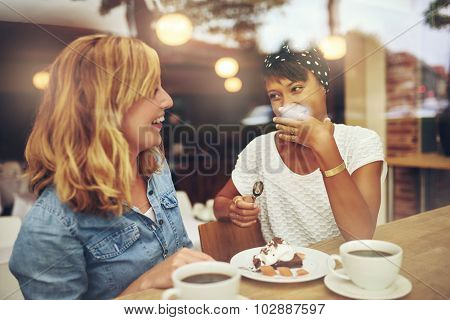 Two Good Friends Enjoying A Cup Of Coffee