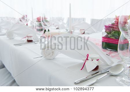 white nuptial decorated wedding table with napkin and flowers