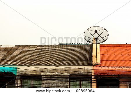Satelite Dish On The Roof And Cloud Sky Background.