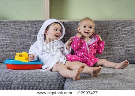 Cute Siblings In Bath Robes