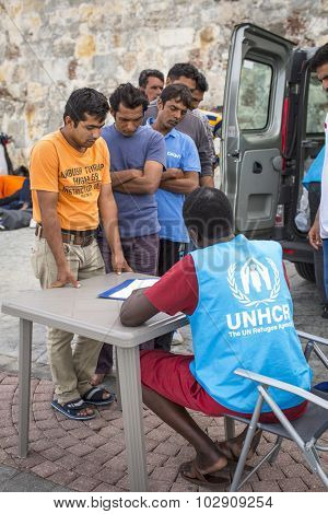KOS, GREECE - SEP 27, 2015: War refugees are registered employees of UNHCR. Kos island is located just 4 kilometers from the Turkish coast, and refugees come from Turkey on inflatable boats.