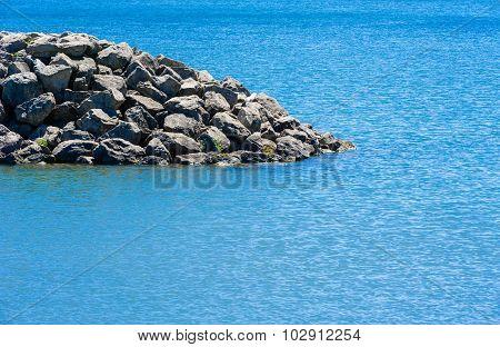 Edge Of Rocky Breakwall Ending In Water